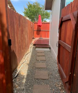 """42"""" wide gate to back deck. Small rock on wide path. Two steps up to deck to get into the Suite."""