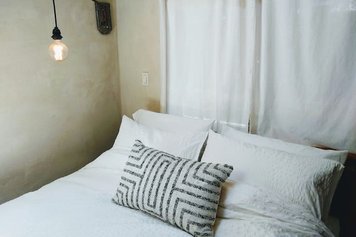 Bedding is 100% cotton with a down blanket and choice of down or synthetic pillows.