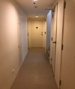 The entrance to Unit #102 is well-lit and flat with no slop or steps.