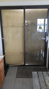 Sliding glass doors from inside (boarded up for winter).  Width of entrance is 27.5.