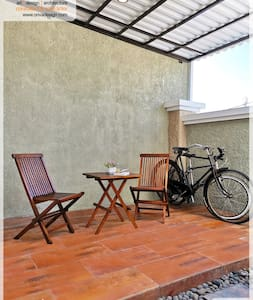 Front Terrace, the guest will come to this terrace once getting in the Gapura (Front Entrance). We have lighting in every outdoor area: front wall separated villa with the road, gapura, front terrace, facade, carport & backyard include pool.