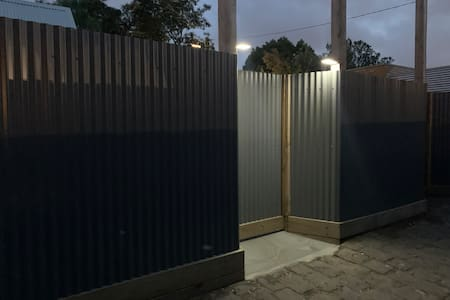Front gate has solar nighttime lighting. Inside path too but that is often off. Just ask to have everything turned on before arrival. We are planning more comprehensive lighting.