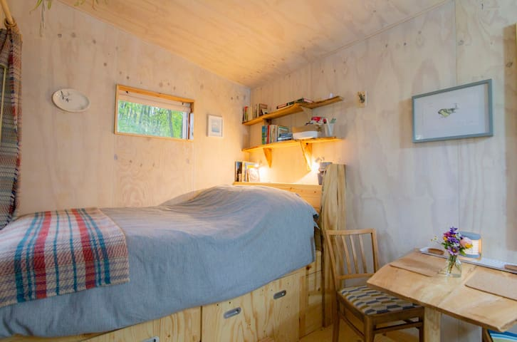 The comfortable bed has organic bed linen and a recycled PET bottle mattress. There are also pull out storage drawers for clothes, gear and luggage