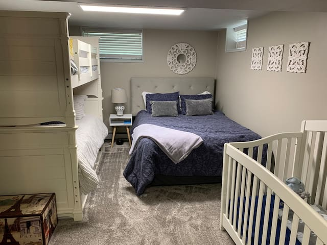 The large bedroom was recently rearranged to allow for twin bunk beds to fit, along with the queen bed and full-size crib.