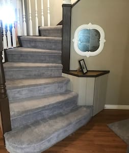 There is a spiral staircase that brings you up to rooms 3,4,5 and a full bathroom as well as . The rest of the house that is accessible to bnb clients is of Main floor access. Rooms 1,2, kitchen, dining, living,sun,laundry Rooms, patio &1.5 bathrooms