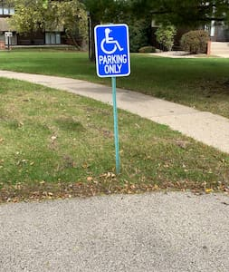 Handicapped spot. It's next to the sidewalk you'll take to the unit easily.