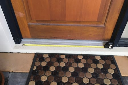 More than 32 inches/80cm wide. Yellow tape is this length.
