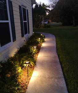 Well lit path to entrance