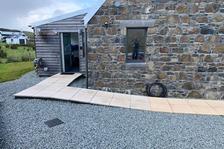 Firm paving slabs path from car parking up to entrance door.