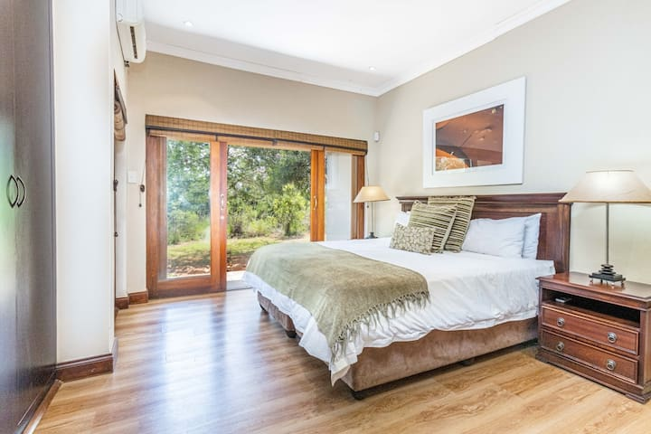 Master bedroom that effortlessly flows out into the bushveld outside
