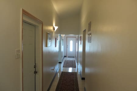 "Hallway with all openings to other rooms and spaces at least 36""."