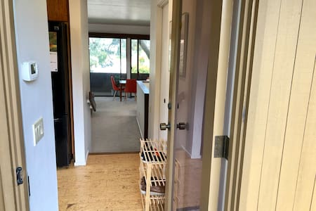 Entry door. We have moved the shoe rack visible in this picture.