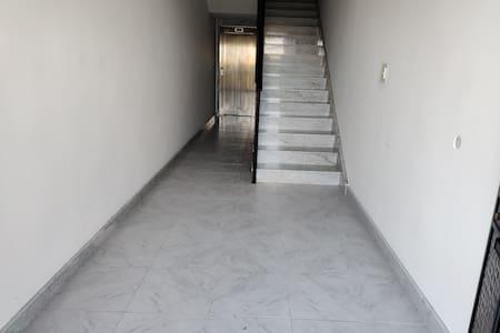Hallway at main entrance leading to lift.