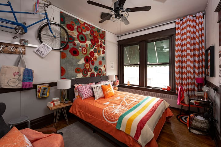 Tandem Room: Sink into the Queen memory foam mattress with fun tandem bicycle bedding for a good night's sleep.