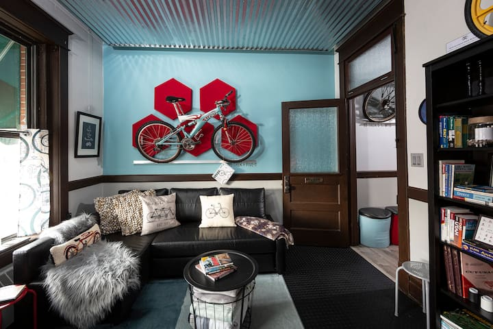 The Bike Library features a pull-out sectional, collectible bikes and lots of custom bicycle artwork and design.