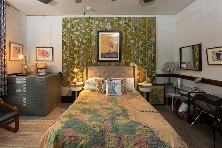 Map Room: As with all the bedrooms, there's a get-ready table, BaByliss blow dryer, magnifying mirror and lamp + room purifier to help you get a good night's sleep. And check out the oh-so-cool bike lamp on the map table.