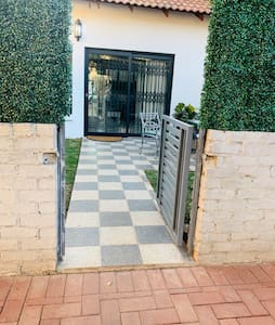 No steps or curbs, flat ground from parking into garden and through sliding door in apartment