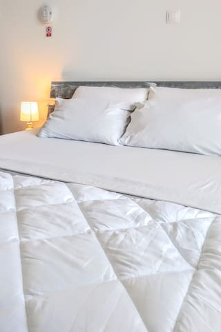 The Studio's king size bed (1.60 x 2.00). Medium soft mattress based on springs.