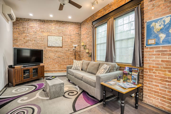 """Living room has a sleeper sofa, 1 of 2 AC wall units, 46"""" flat screen TV with ROKU and free Wi-Fi throughout the loft"""