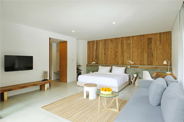 The master suite features a fully enclosed bathroom furnished with Aria Villa's bespoke range of his and her amenities.