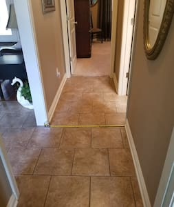 38 inch hallway leading to guest (not master) bedroom, office and guest bathroom.