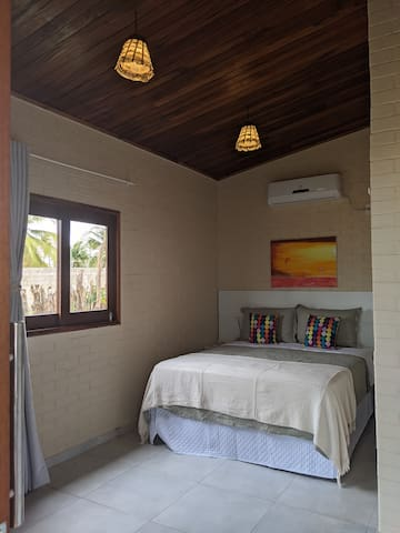 The master bedroom features a queen-sized bed, en-suite bathroom and air conditioning.