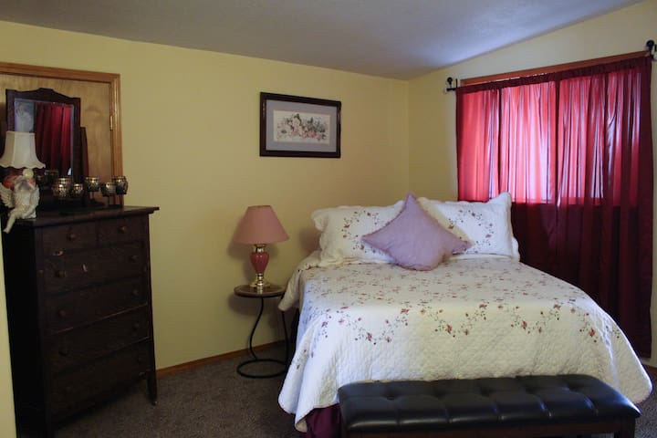 Bedroom #4 has a Queen-sized bed.