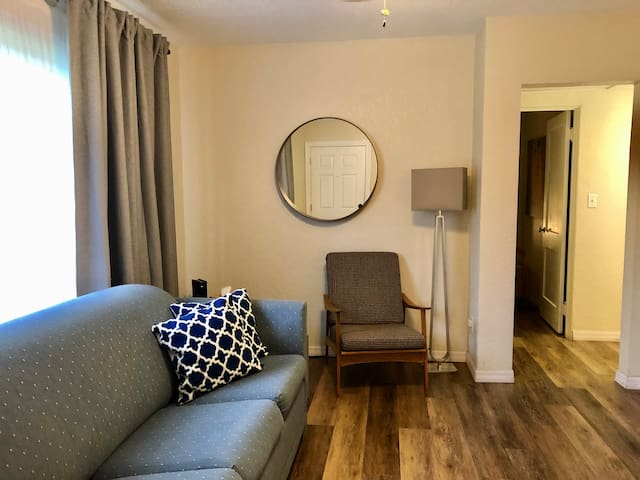 This couch pulls out into a queen mattress and sleeps two additional guests. All the linens and pillows for the sofa bed are provided inside the listing.