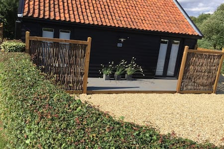 Large parking area and small step up to decking  and to French doors to access