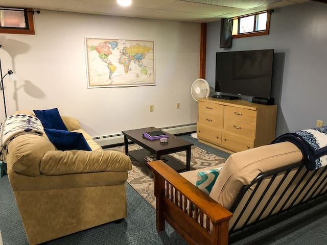 """The """"living room"""" area.  There's Roku TV with Netflix (sorry, no cable) and a binder of DVDs for guests to enjoy."""