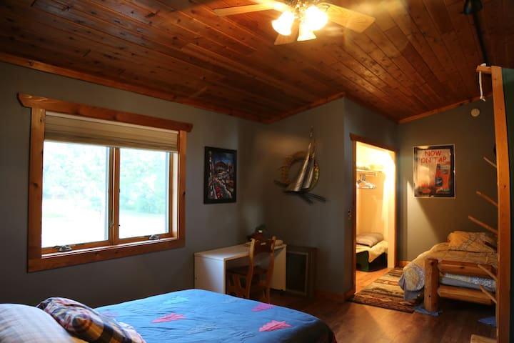 The second upstairs bedroom. 2 full beds, and a closet. Great spot for larger groups or when stay with kids.