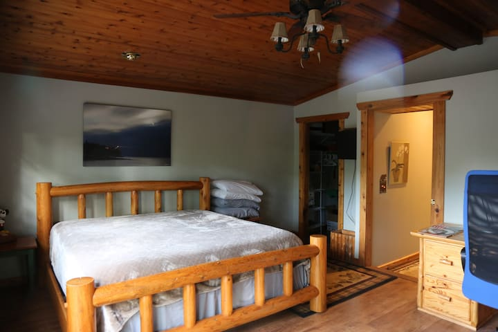 The Master Bedroom has 1 king bed, 1 walk-in closet, 1 working station and a walk-out deck (see next photo).
