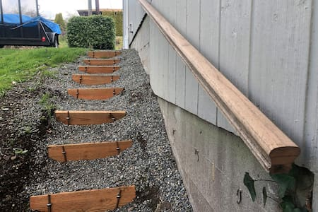 Railing, stairs which are lit by flood lights at night