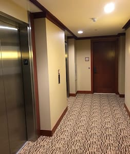 Two elevators have access to our villa's 14th floor entrance shared with only one other villa