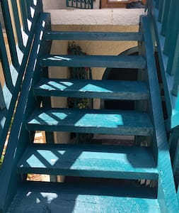 Stairs leading up to condo