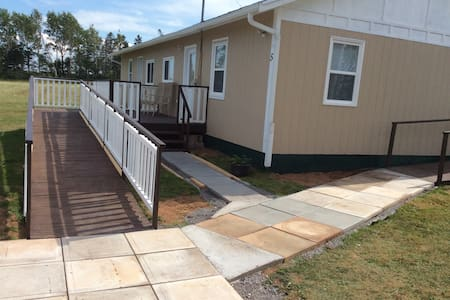 The walkway is wide and flat leading up to the ramp.