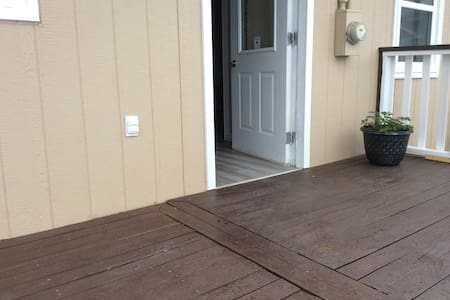 The threshold is flush with the deck.