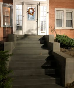 A spotlight aimed at the front entrance and steps keeps illumination bright all night