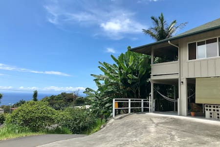 Driveway does have a slope but there is plenty of flat area for access to Ohana safely.