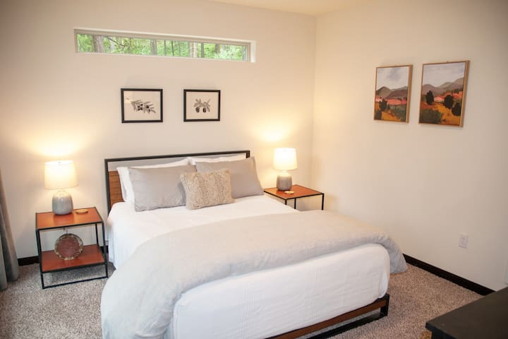 Bedroom #1: Queen memory foam mattress, dresser, closet with luggage rack and large windows.