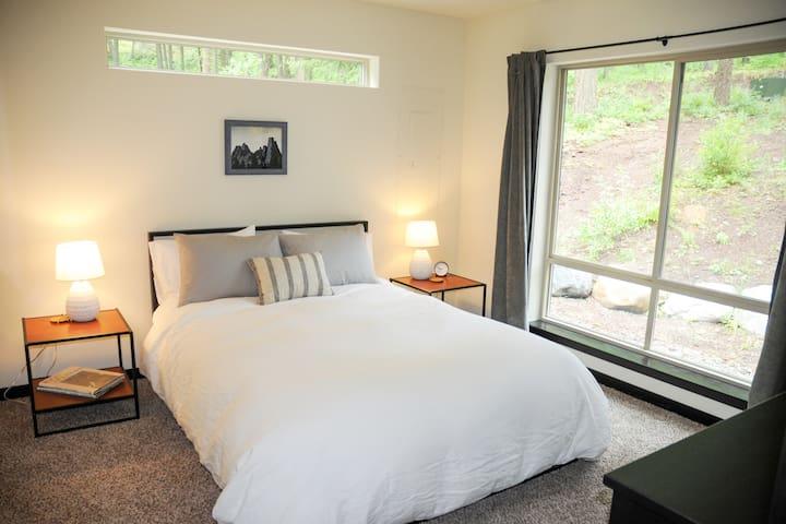 Bedroom #2: Queen memory foam mattress, dresser, closet, luggage rack and large windows.