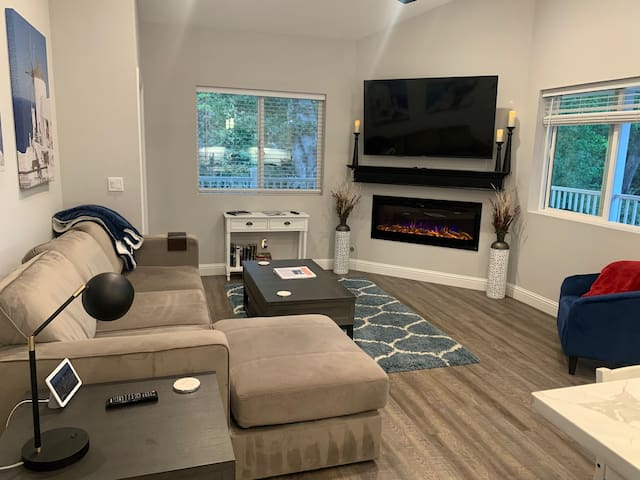 """The home is equipped with a Google Home Hub (which controls the built in ceiling speakers) and a brand new 65"""" 4k Samsung TV and 50"""" Electric Fireplace with multiple color modes."""