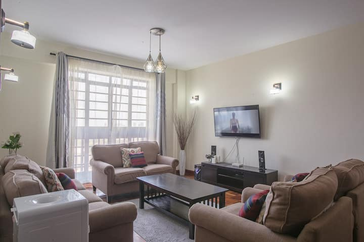 Explore the Nairobi skyline from this cozy loft