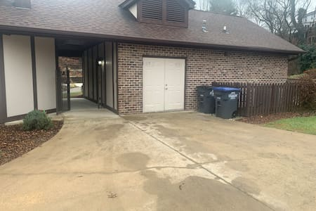 Driveway, gate and front door to apt