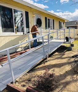 The wheelchair ramp is accessed from the driveway