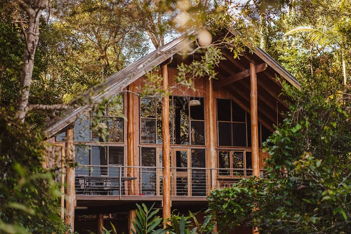 The Bower house in the trees with sweeping views