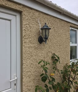 There is an outside light that can be left on if you know you will return after dark.