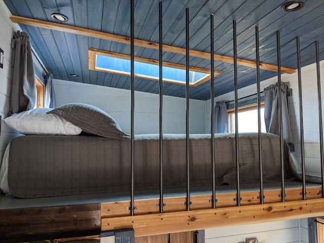 King size bed in the sleeping loft with skylight to enjoy some stargazing at night.
