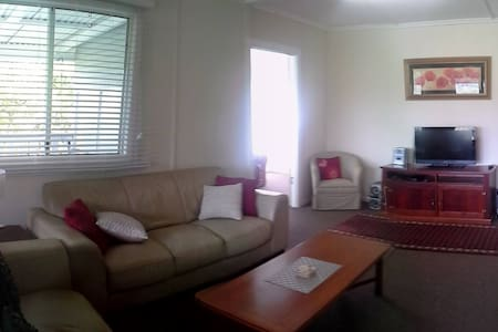 4-way access into the lounge room: from the kitchen, sunroom, hallway or verandah, and all wheelchair friendly :)