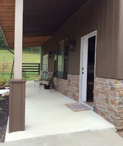 Main Entrance has wide porch with outdoor lighting.